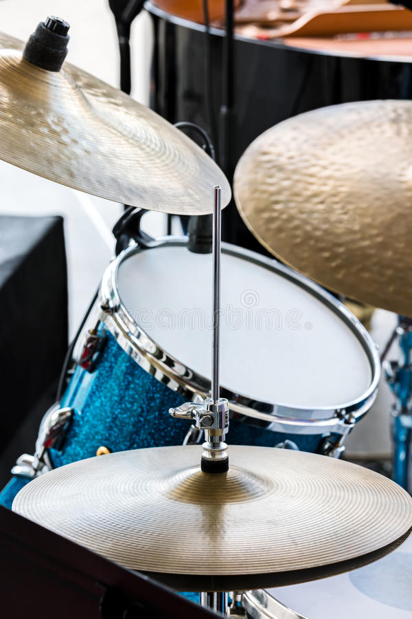 Blue drum and copper cymbals standing in street for musical performance. Blue drum and copper cymbals standing in the street for musical performance stock image