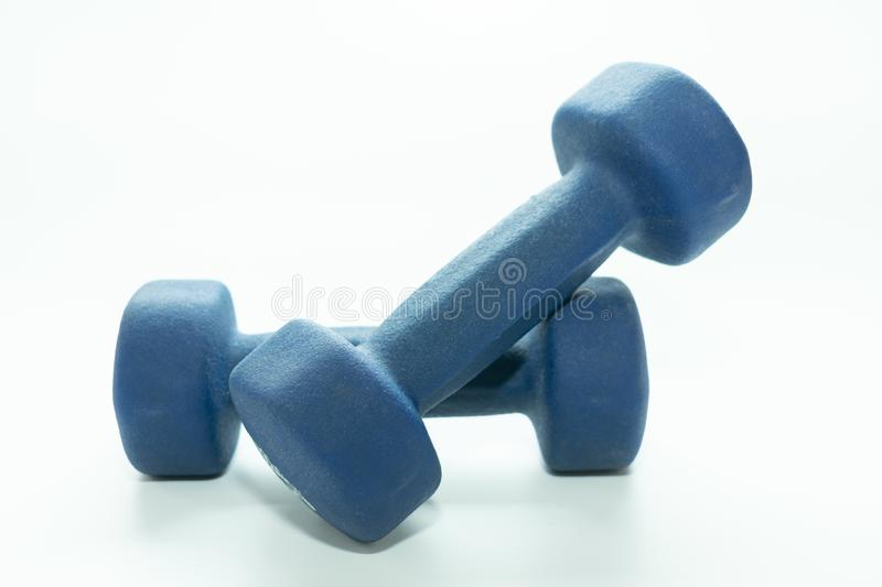 Blue dumbbells for sports stock images