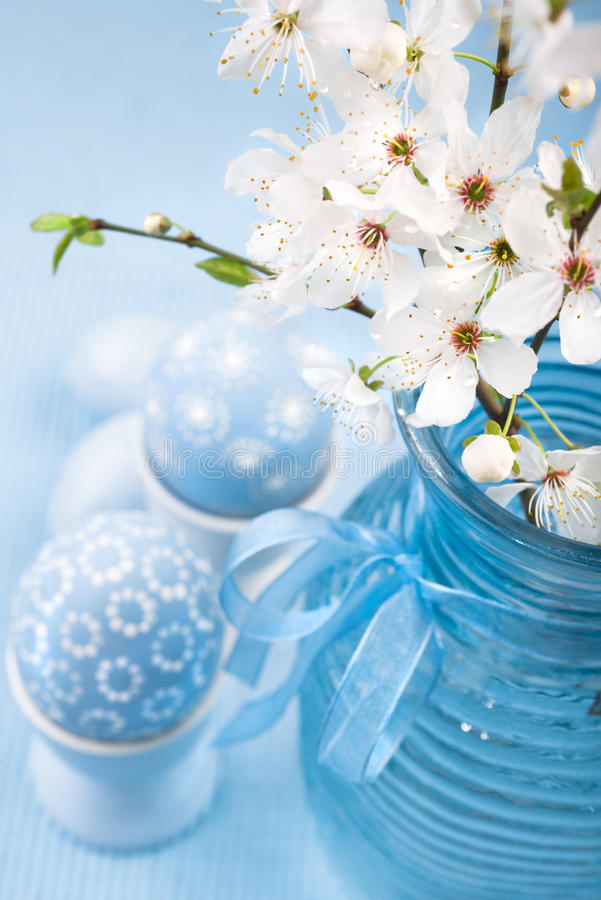 Blue Easter eggs and cherry blossoms, space royalty free stock photography