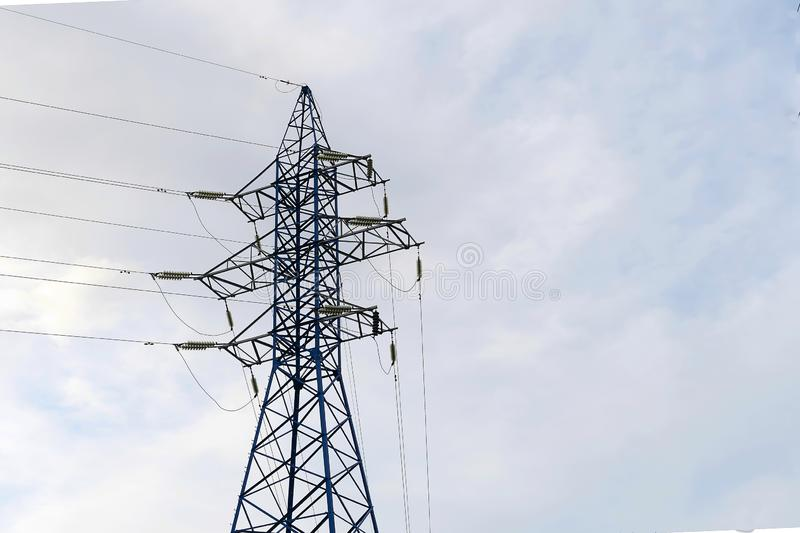 A blue electric pole holds the gear line. High voltage wireline. Electricity transmission, volt. Energy royalty free stock photos