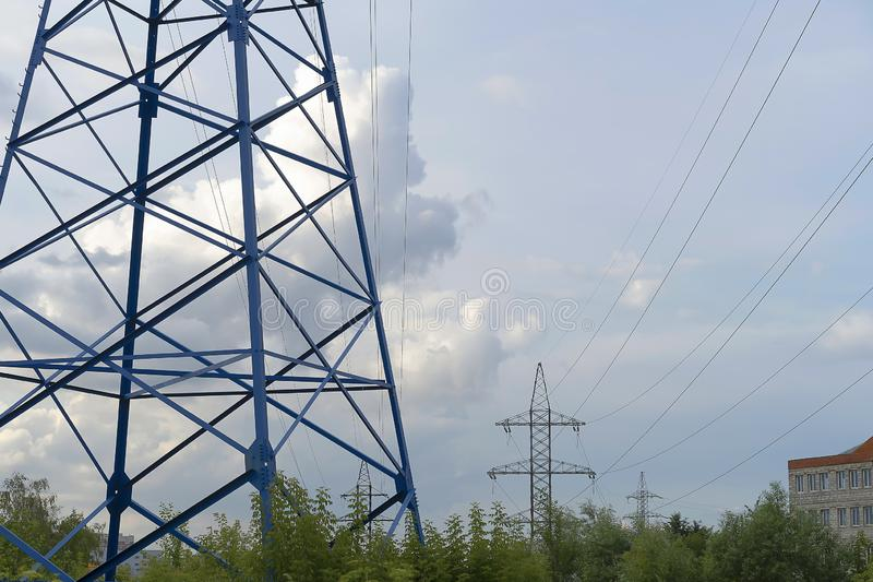 A blue electric pole transmits energy. High voltage line with wires. Electricity transmission, volt. Energy stock image