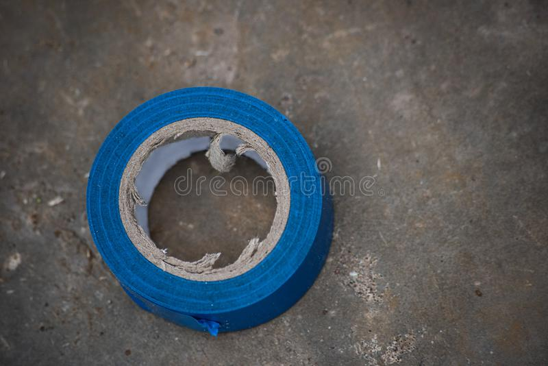 Blue electrical tape on a rough surface. From above, sticky, plastic, adhesive, insulation, insulating, roll, protection, tool, fix, circle, object, industry royalty free stock images