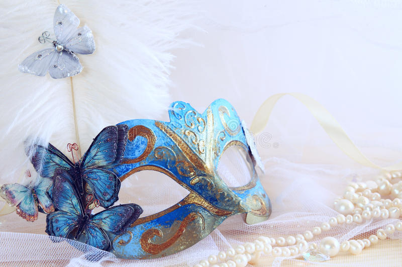 Download Blue Elegant Venetian Mask Next To Pearls Stock Image - Image: 83702177