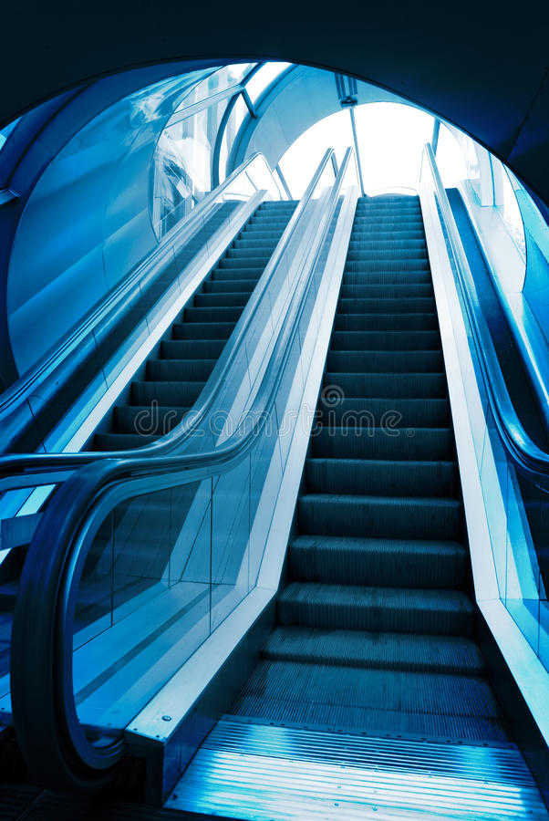 Blue elevator elevators. Blue elevator staircase within interior of a corporate building stock image