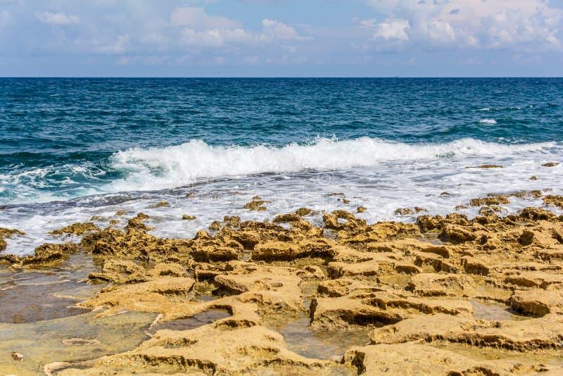 Blue emerald Mediterranean sea with stone beach in Sliema, Malta stock photo