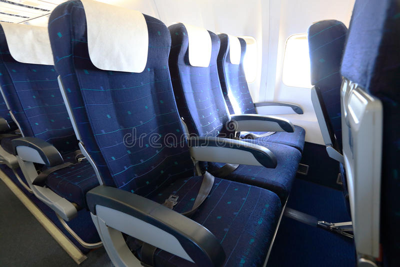 Blue empty aircraft seats stock photography