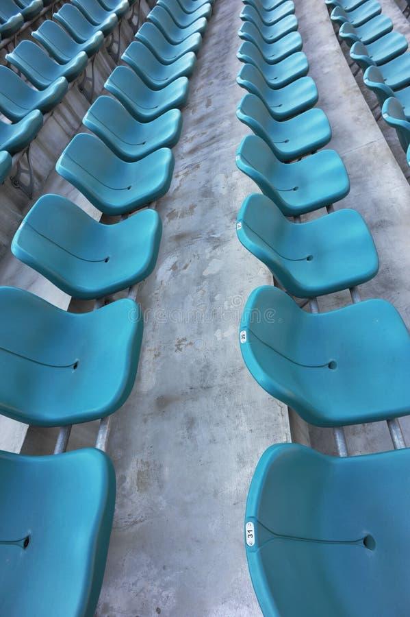 Blue empty stadium seats royalty free stock photography