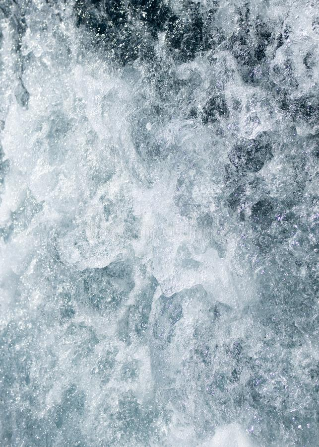 Simple blue end white water wave background stock photo