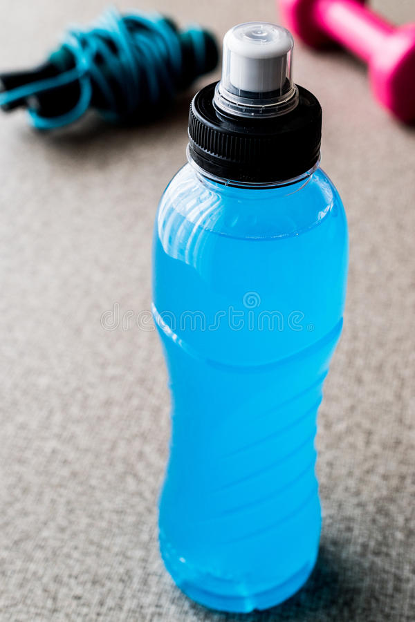 Blue Energy Drink with skipping rope and dumbbell. Sport Concept stock images