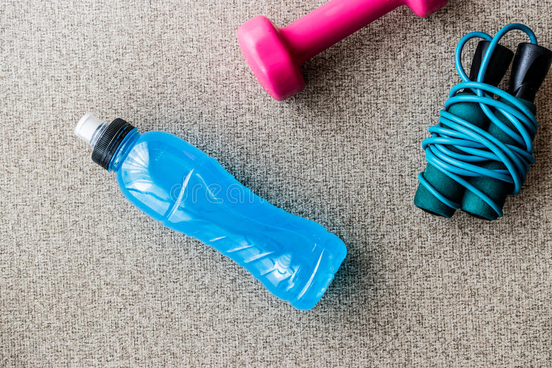 Blue Energy Drink with skipping rope and dumbbell. Sport Concept royalty free stock images