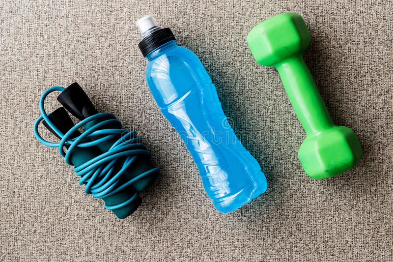 Blue Energy Drink with skipping rope and dumbbell. Sport Concept stock photo
