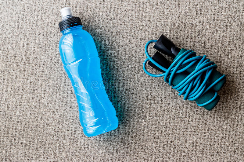 Blue Energy Drink with skipping rope. Sport Concept royalty free stock photo