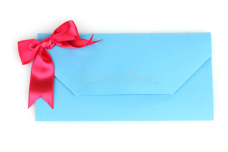 Blue envelope. Beautiful blue envelope with bow isolated on white stock photo