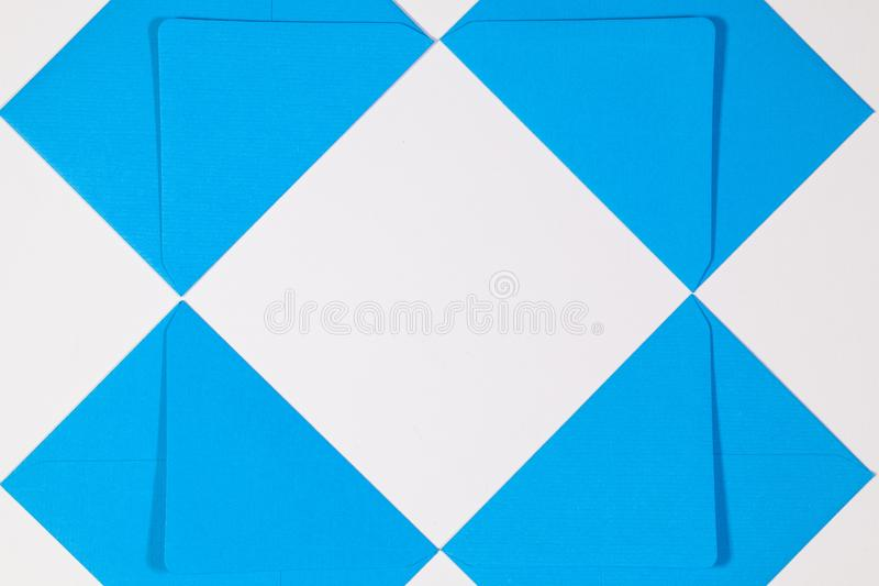 The blue envelopes on the white table. Pattern from blue envelopes on the white table stock photo