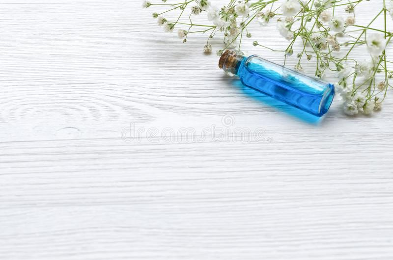 Blue essence healing tincture on white wooden table background. Essential oil. stock photography
