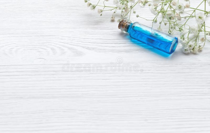Blue essence healing tincture on white wooden table background. Essential oil. royalty free stock photos