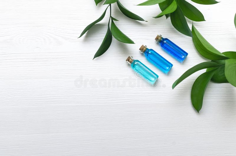 Blue essence oil tincture on white wooden background. stock image