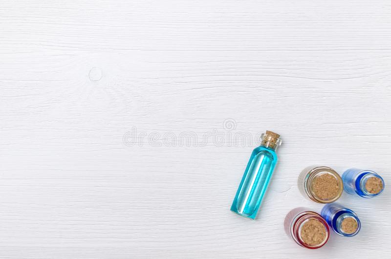 Blue essence oil tincture on white wooden background. royalty free stock images
