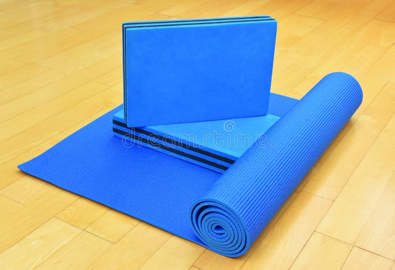 Blue exercise Mat and blocks for Yoga or Pilates royalty free stock images