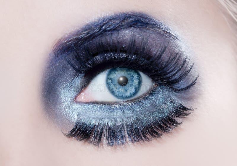 Blue eye fashion makeup closeup macro winter black stock images