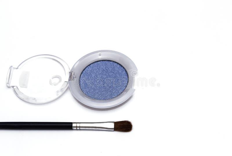 Blue eye shadows and eye brush isolated on white background. Blue eye shadows and eye brush  isolated on white background. Concept of makeup and beauty royalty free stock image