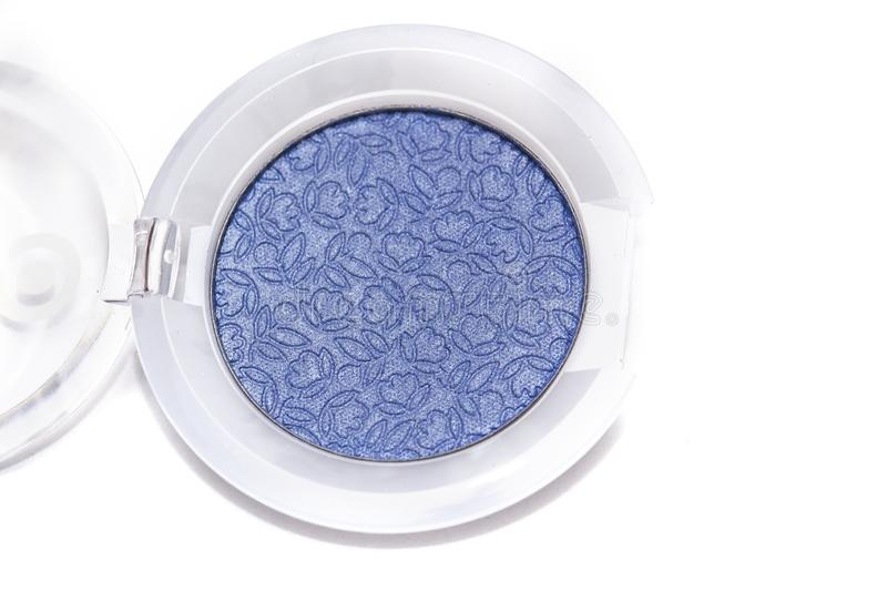 Blue eye shadows isolated on white background. Blue eye shadows and eye brush  isolated on white background. Concept of makeup and beauty royalty free stock photography