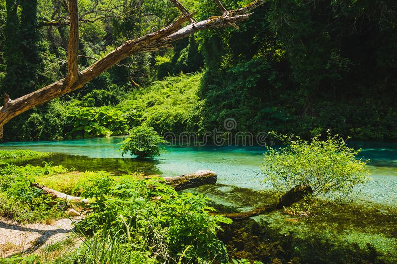 Blue Eye spring and river in Albania, Saranda area. Syri i Kaltër - Blue Eye - geological phenomenon where a stream of fresh, cold water flow to the surface royalty free stock image