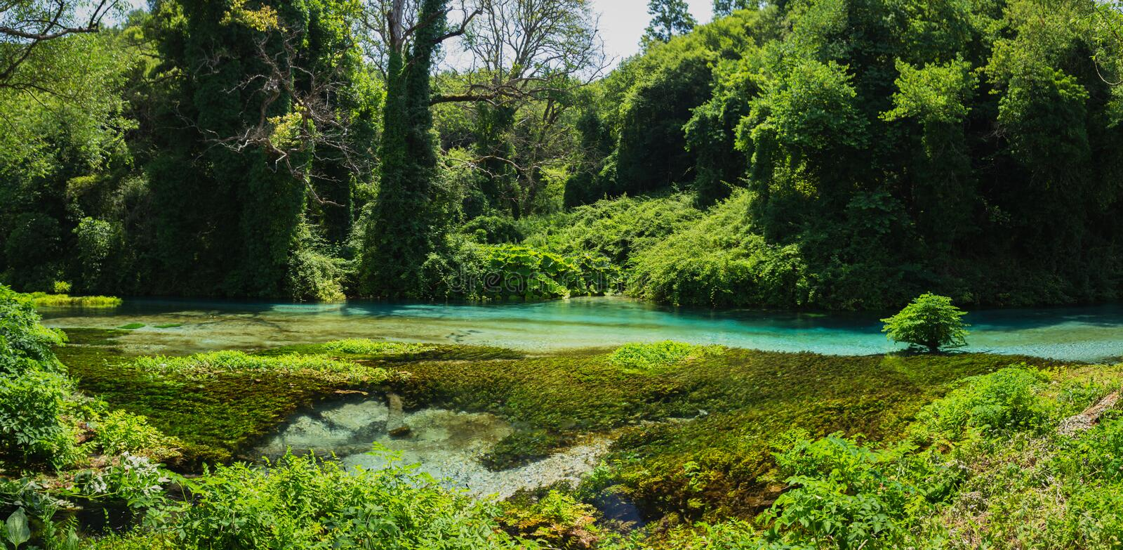 Blue Eye spring and river in Albania, Saranda area. Syri i Kaltër - Blue Eye - geological phenomenon where a stream of fresh, cold water flow to the surface stock photo