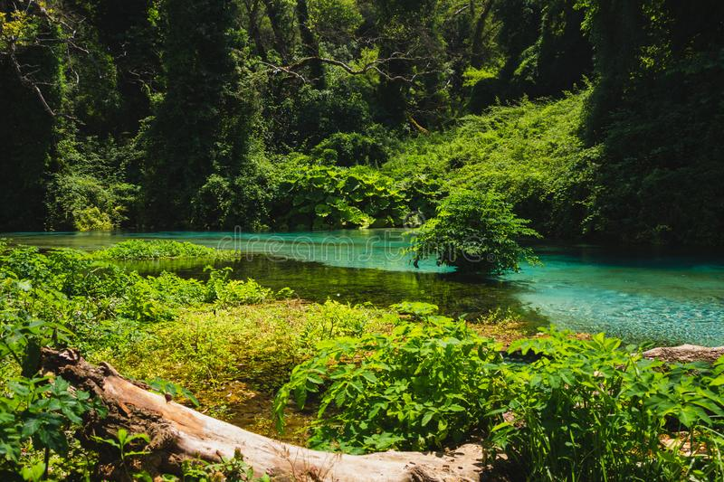 Blue Eye spring and river in Albania, Saranda area. Syri i Kaltër - Blue Eye - geological phenomenon where a stream of fresh, cold water flow to the surface stock photos