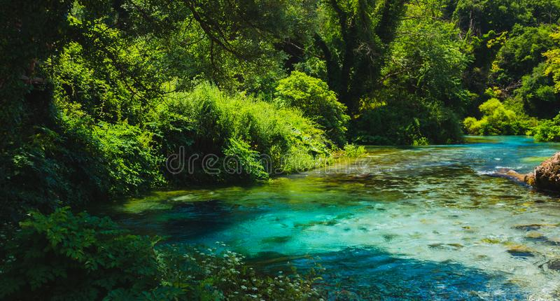 Blue Eye spring and river in Albania, Saranda area. Syri i Kaltër - Blue Eye - geological phenomenon where a stream of fresh, cold water flow to the surface stock photography