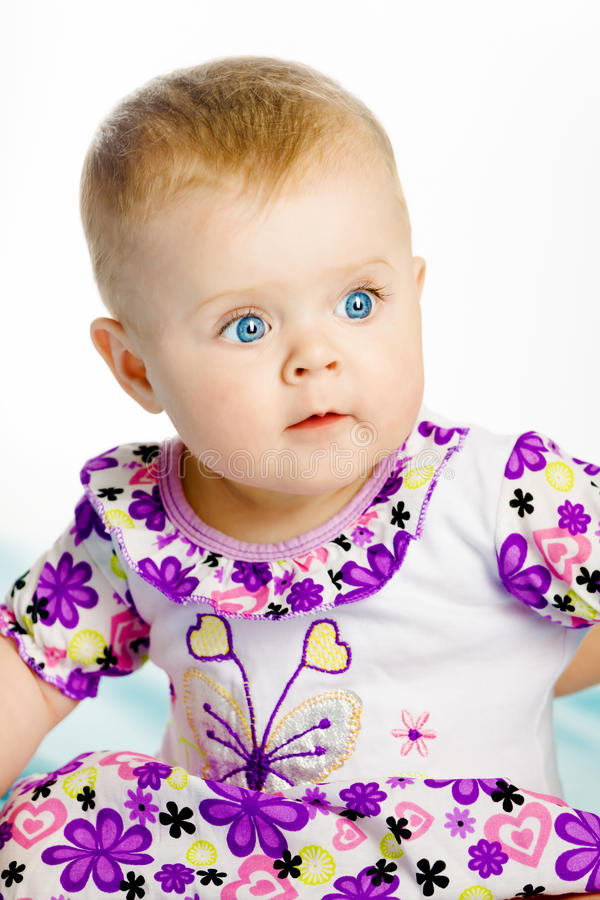 Blue-eyed baby girl. Portrait. Close-up stock images