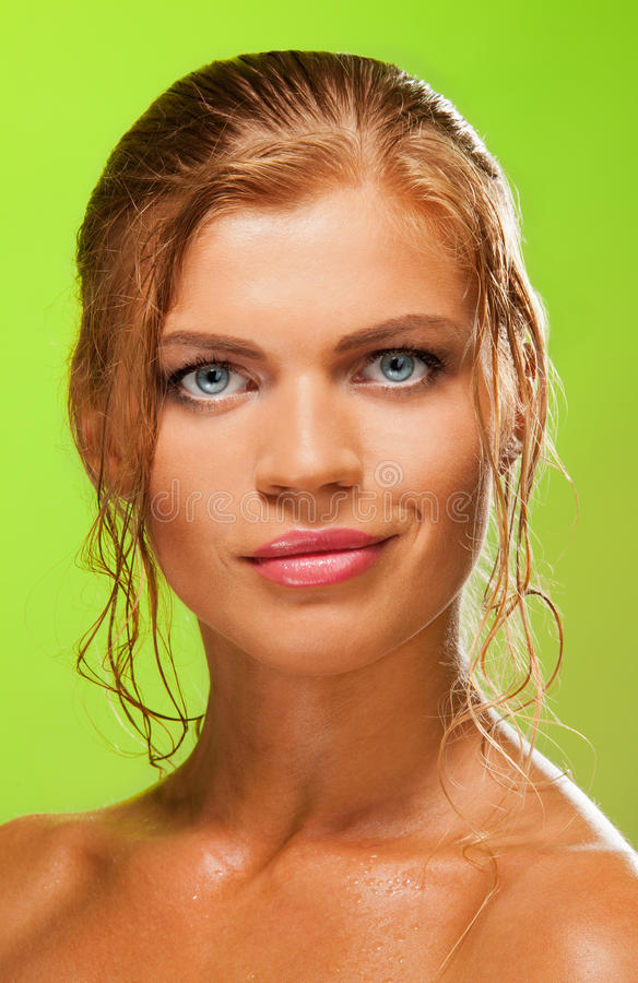 Blue-eyed blonde girl enface stock photography