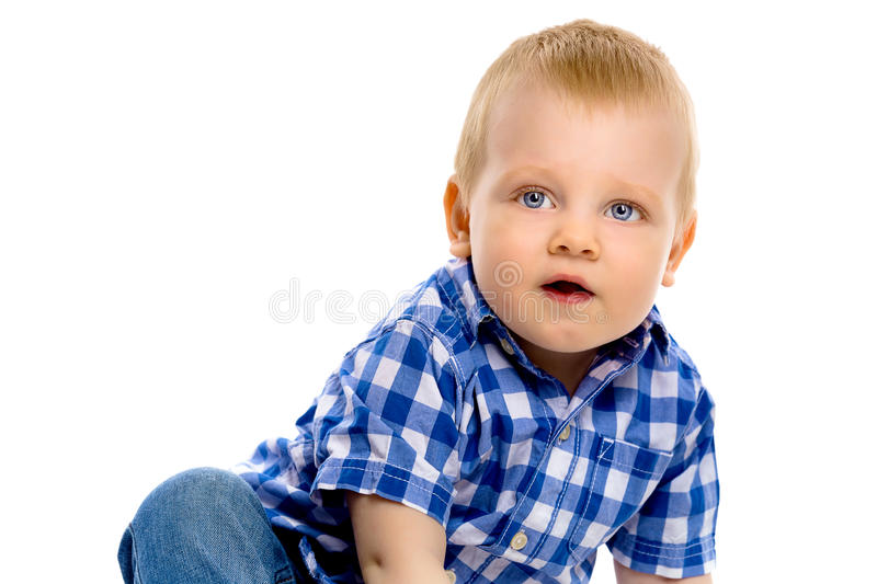 Blue-eyed boy in a plaid shirt royalty free stock photo