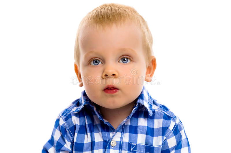 Blue-eyed boy in a plaid shirt stock images