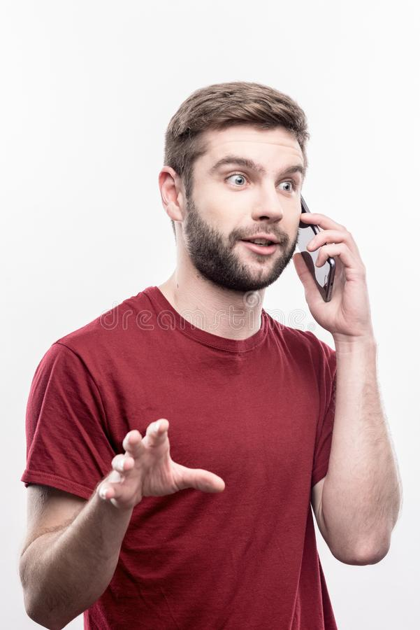Free Blue-eyed Businessman Feeling Surprised While Calling His Business Partner Royalty Free Stock Image - 125414806