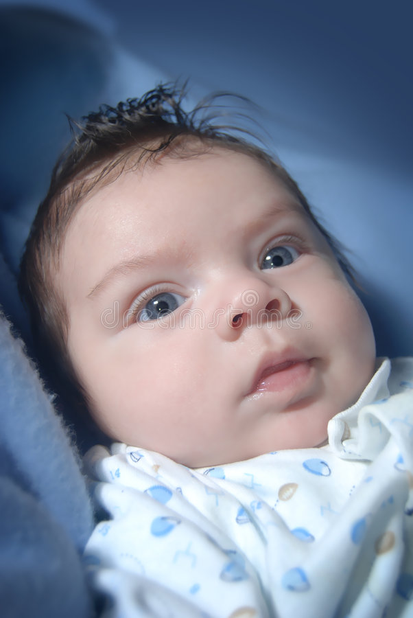 Blue eyed, dark hair infant - close up royalty free stock images