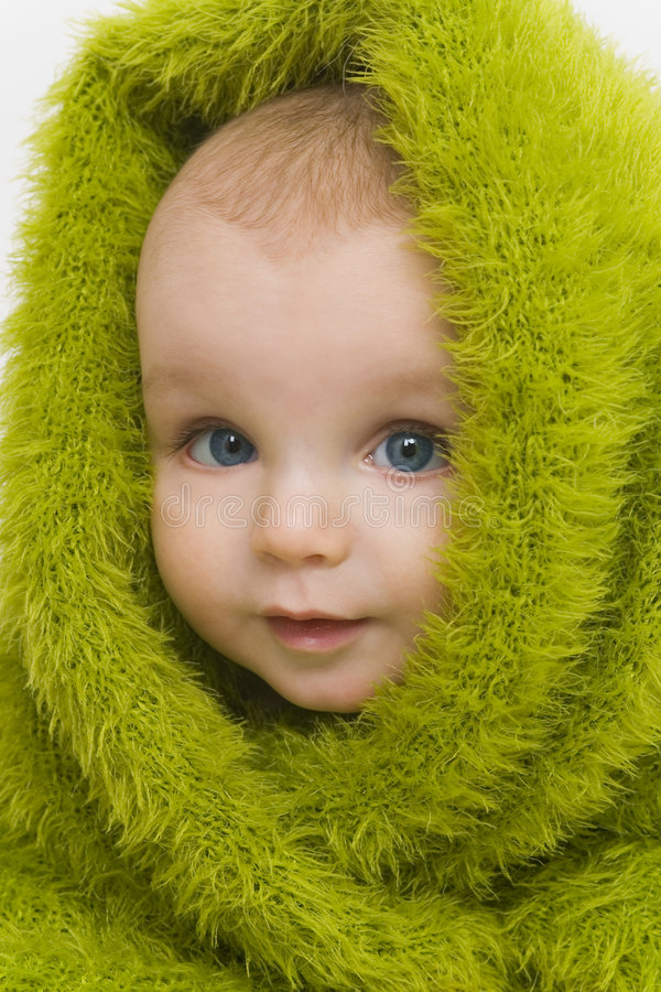 Blue Eyed in Green III. A blue eyed baby wrapped in a furry green blanket