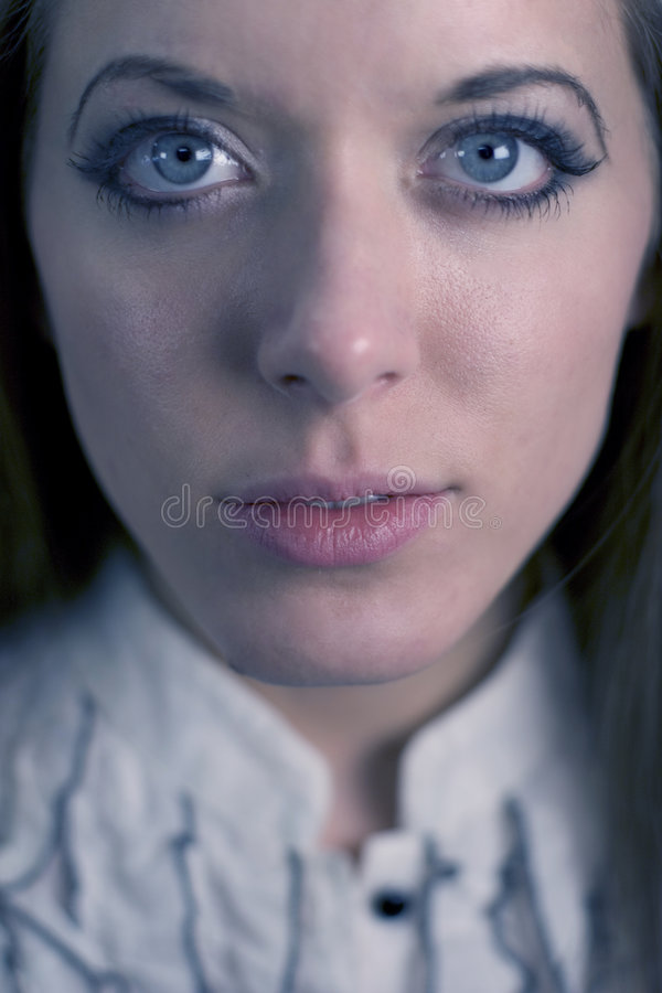 Blue eyed lady stock image