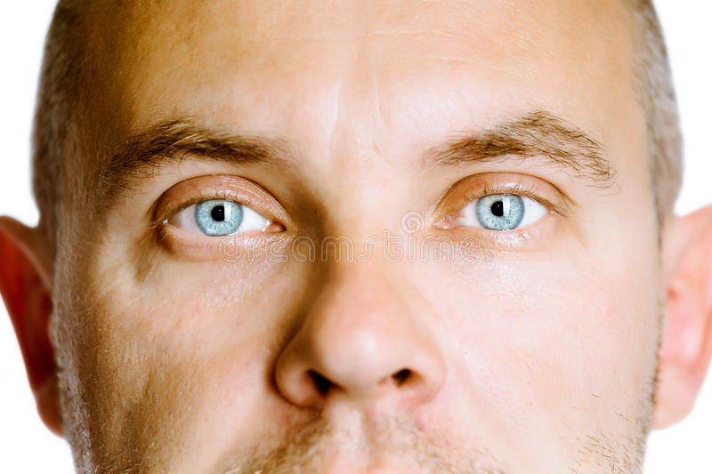 Blue-eyed man. The face close up. Studio. isolated stock photos