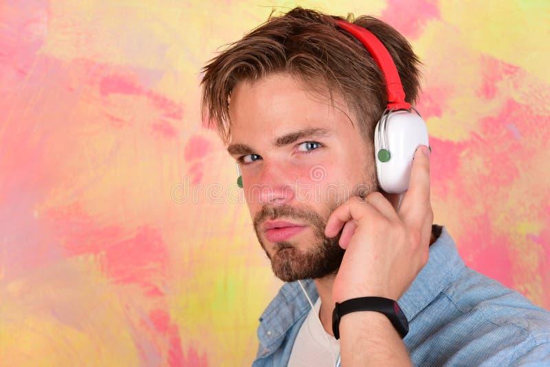 Blue eyed stylish hipster with smartphone. stock photos