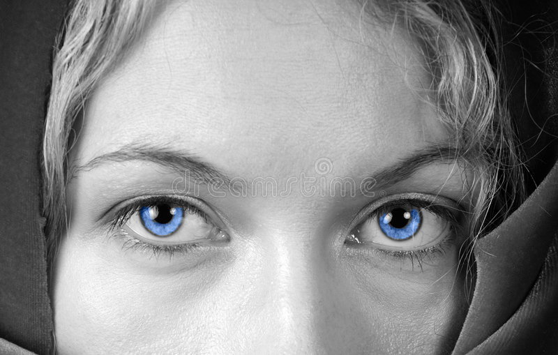 Blue eyes. Black and white closeup of beautiful woman with stunning blue eyes royalty free stock photo