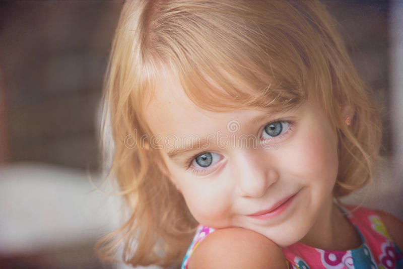 Blue Eyes. A blonde haired girl with blue eyes looking off into the distance stock photos