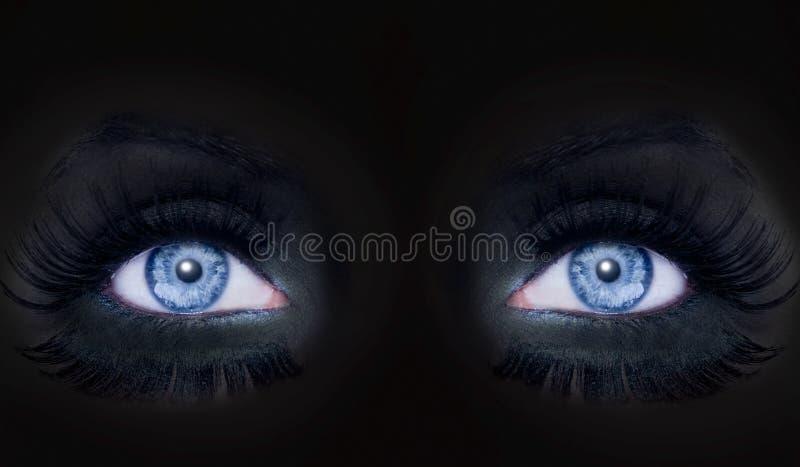 Blue eyes darked face makeup black panther woman royalty free stock photos