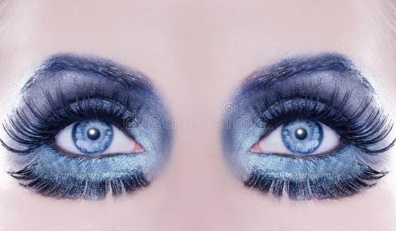 Blue eyes macro closeup fantasy fashion makeup stock images