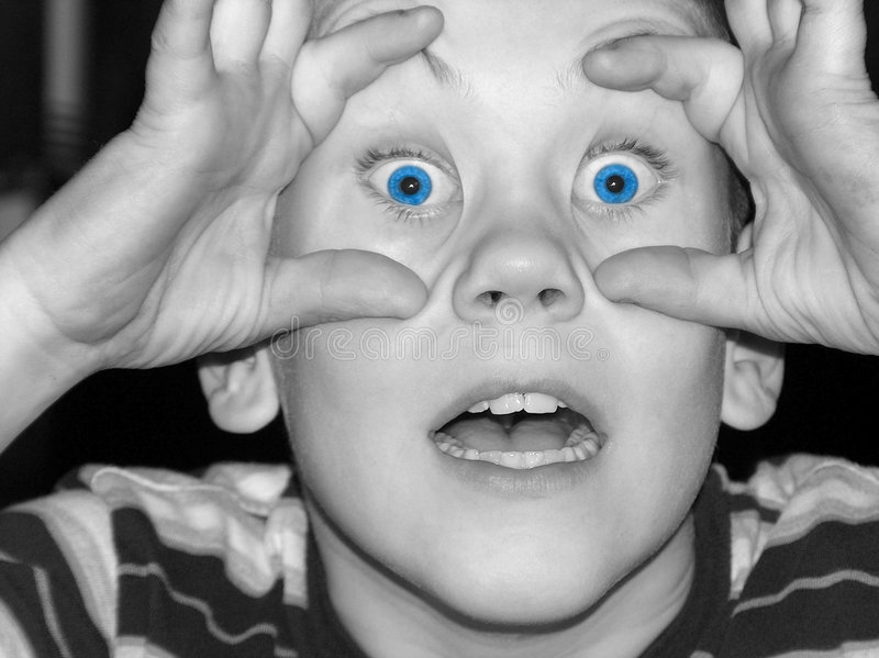 Blue Eyes Surprised. Boy making faces at the camera. Black and white with bright blue eyes