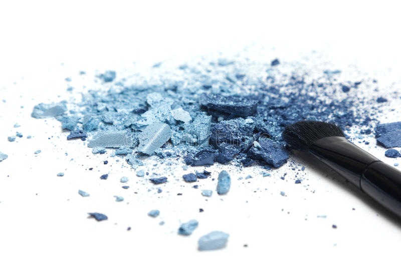 Blue eyeshadow different shades with makeup brush royalty free stock image