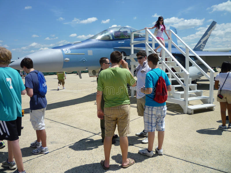 Blue F18 Hornet and Crowd stock image
