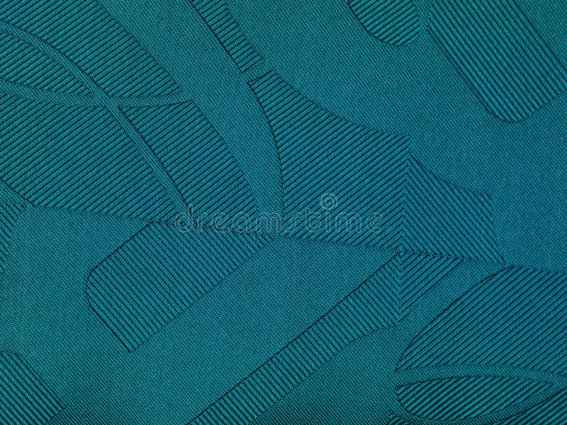 Blue fabric with bumps and shades. Close up royalty free stock image