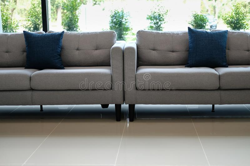 Blue fabric pillow on sofa couch furniture in living room. Blue fabric pillows on sofa couch furniture in living room near window royalty free stock image