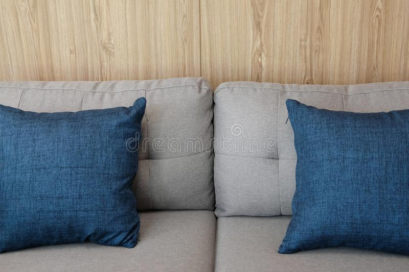 Blue fabric pillow on sofa couch furniture in living room. Blue fabric pillows on sofa couch furniture in living room royalty free stock photography